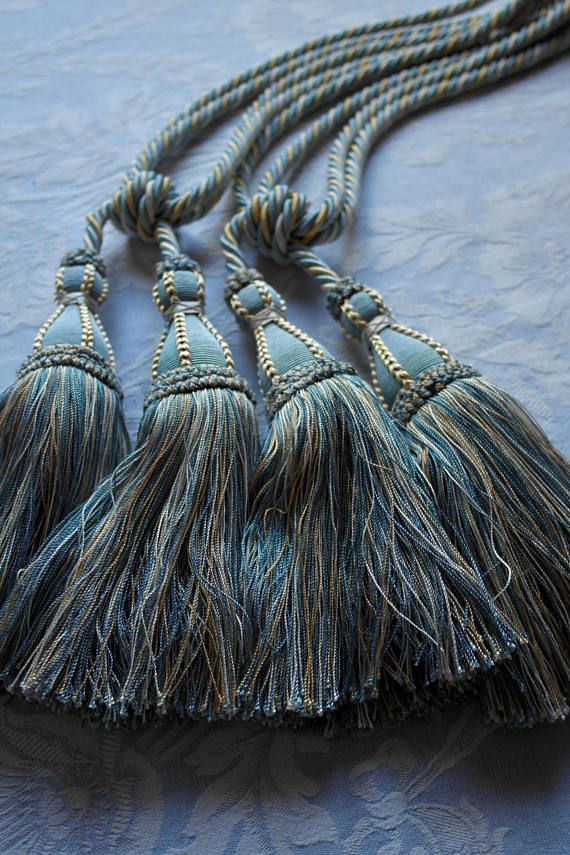 Vintage curtain tieback tassels, a pair of Pompom French divine 1980s blue and cream, beautiful curtain holdbacks, passementerie, pom poms. A pair of French curtain tiebacks dating from the early 1980s, they look as new. These French curtain tiebacks are generous, beautiful and well made. The heavy doubled cord threads of the tassels are worked around a wooden interior mount (not visible). The twisted corded ropes go through a small mold that is covered in the most divine contrasting…