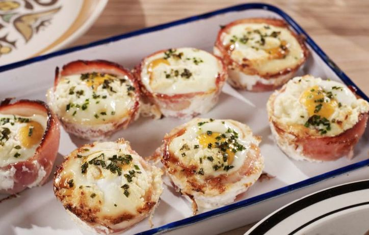 Egg and bacon cup cakes - Wrap bacon around  the inside of a muffin tin, crack an egg in each whole, sprinkle with crumbled feta and chives or other herbs. Cooked for about 15 mins. From Sara Wilson's 'I Quit Sugar' book. I have frozen them for a future breakfast or meal. Amazing!!