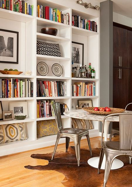 This picture is like someone jumped in my brain.  Bookshelves in dining rooms, always a YES.