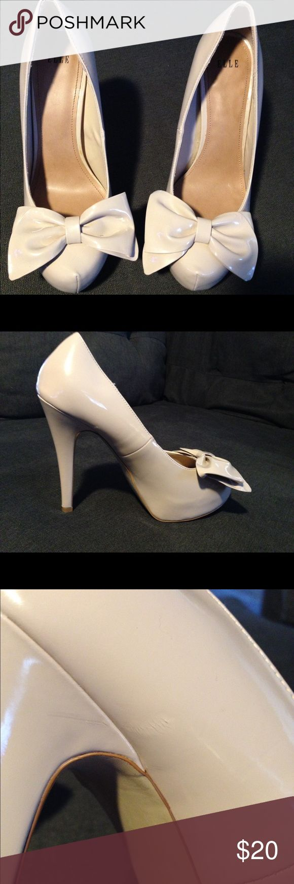 Elle nude high heel shoes with the bow size 8 1/2 ELLE nude high heel women's shoe with Bow. Size 8 1/2. Heel measures approximately 4 to 4.5 high. Preowned in great condition there is a small scuff. I've taken a photo for you to view it. very comfortable shoe. Original price $75. Only worn a couple of times. Beautiful shoe sexy shoe. Check out my other items to combine shipping. elle Shoes Heels