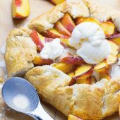 Warm Rustic Peach Galette with a scoop of vanilla ice cream on top is a very simple but mouthwatering summer treat. This easy dessert recipe is perfect for any celebration.