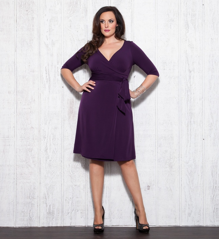 Plus Size Purple Perfection!  Made from a dressy jersey knit fabric that skims your curves, the Plus Size Rita Faux Wrap Dress by Kiyonna is the perfect dress to wear to any of your special events including weddings, cocktail parties, graduations, etc.  We love it with black or nude colored pumps and either gold or silver accessories.  #plussize