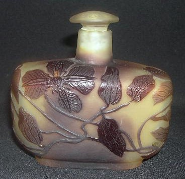 Galle Perfume Bottle, With Raised Leaves And Branches On A Yellowish To Brown Background.