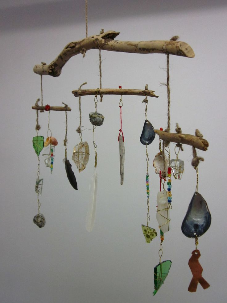 Rustic Tribal Found Object mobile.. think of the bioharmony hanging succulent arrangements with beautiful wood elements