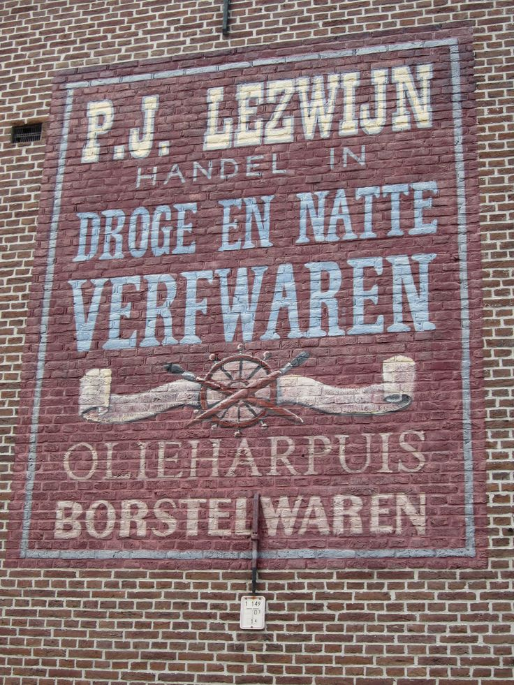 One of the many old wall adverts in Leiden; situated on the Oude Rijn.