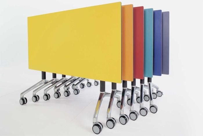 I.AM Turn   UCI Table.  Tilt-top stacking table for workplaces that demand flexibility such as boardrooms, training rooms and temporary desking. uci.com.au