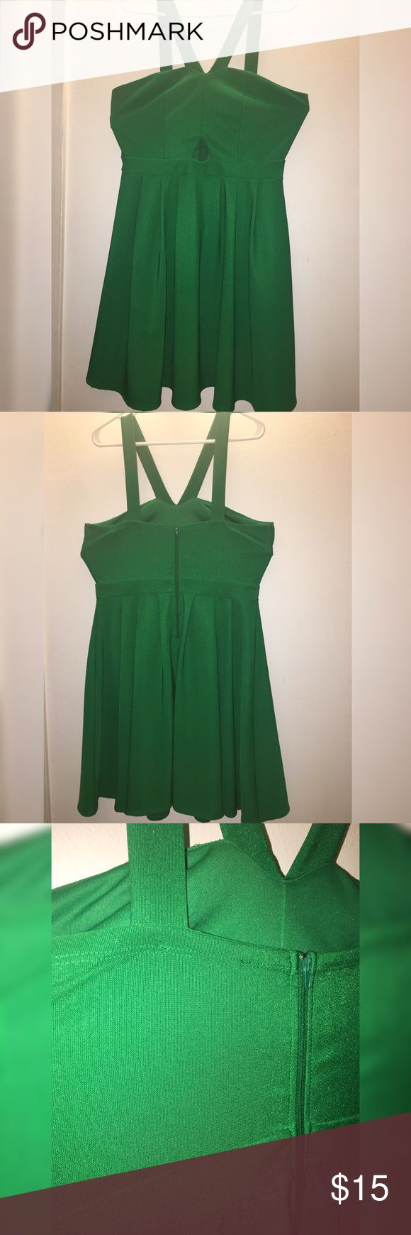 Emerald green dress Beautiful emerald green flowing dress. This dress hits just above the knee, Also has a small opening at the top stomach area to show some skin which is super cute! Great quality material, not brand new but is in excellent condition. This dress is perfect for a girls night out or events! Forever 21 Dresses