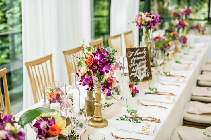Tropical Destination Dinner Tables adorned with Colorful Flowers