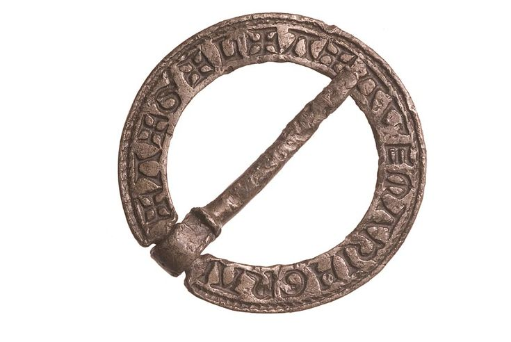 The inscription on this pewter brooch was a powerful charm. It says '+A+G+L+A+AVEMARIAGRA'. 'AGLA' was a magical formula used to ward off fever. It came from the initials of the Hebrew words 'ate gebir leilam adonai' ('Thou art mighty for ever, Lord'). The other part of the inscription is in Latin and stands for 'Ave Maria gracia plena', meaning 'Hail Mary full of grace'. late 13-early 14 century   Museum of London