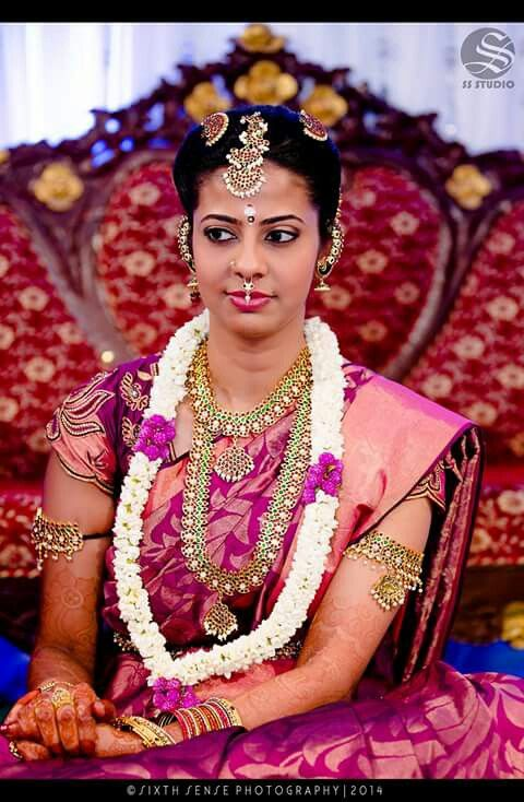 South Indian bride. Temple jewelry. Pink silk kanchipuram sari. Braid with fresh flowers. Tamil bride. Telugu bride. Kannada bride. Hindu bride. Malayalee bride.