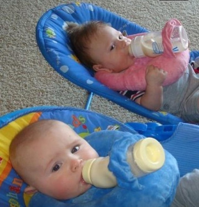 Best baby bottle holder!!  Need an extra hand, but your right there!!  This is great for the car, restaurants, malls and around the house!  A must with multiples!!  Doesn't attach around the neck and great reviews!  order online at bellababydesigns.net or amazon.com!! Also in baby talk magazine!