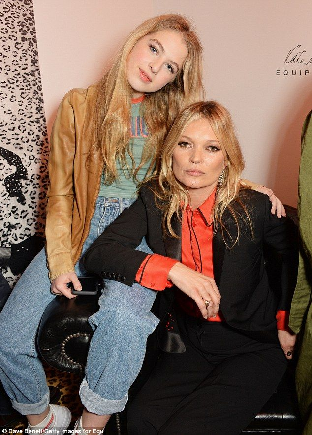 Sitting comfortably: Noel Gallagher's daughter Anais, 16, placed an affectionate hand on K...