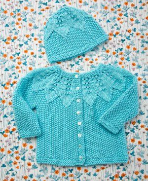 Watch as baby sparkles and shines in the Seed Stitch Baby Set. This darling knit cardigan pattern and matching baby hat pattern feature a gorgeous star lace motif around the yoke and crown of the set.