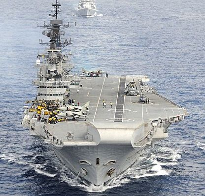INS Viraat is the world's oldest Aircraft Carrier still in Service. She was commissioned in November 1959 as the Centaur Class HMS Hermes.
