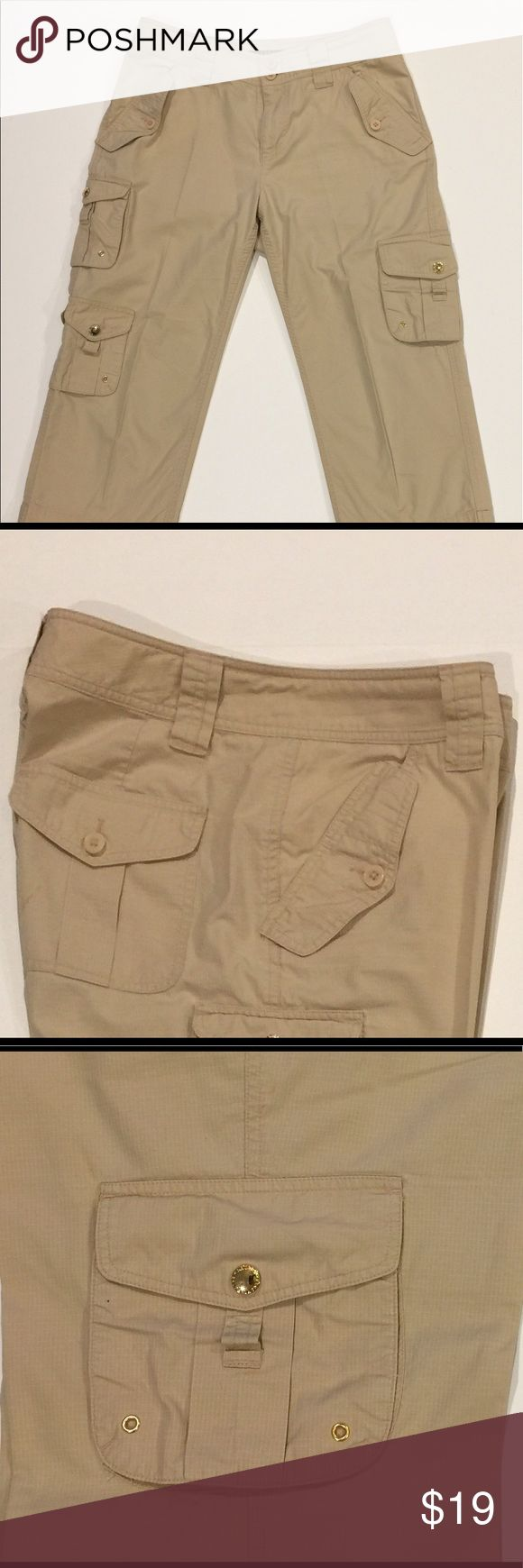 """Lauren Ralph Lauren Pants Cargo Khaki Pockets Zip Lauren Ralph Lauren Women's Pants Cargo Capri Khaki Pockets Zips Sz 6 Cotton  Size: 6 Waist: 32"""" Inseam: 21"""" Rise 9 1/2"""" Color: khaki  Condition: excellent Defects: None  This garment is in gentle used condition. There are no stains, spots, pills, or signs of wear.  This item comes from a smoke free pet free environment. Please follow us on our store and never miss another sale! Lauren Ralph Lauren Pants Capris"""