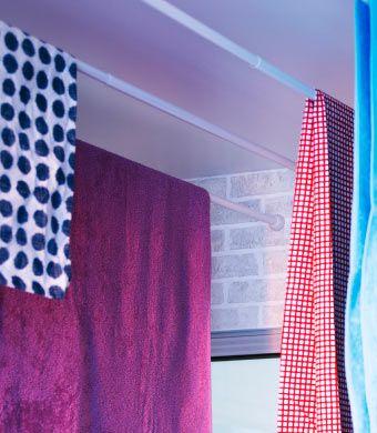 Drie ORE douchegordijnstangen gebruikt als droogrekken