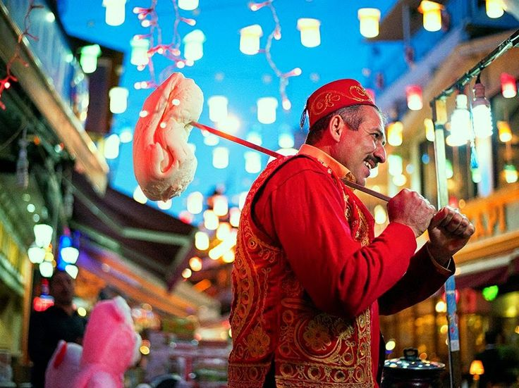 A colorful ice cream vendor in Turkey makes a show for his customers. Dondurma, as the treat is known there, is thicker and chewier than traditional ice cream.