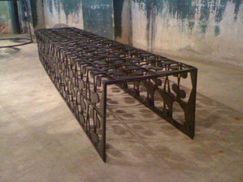 Love the rustic, but gracefulllook.  Scrap Metal Table by Bevara Design House