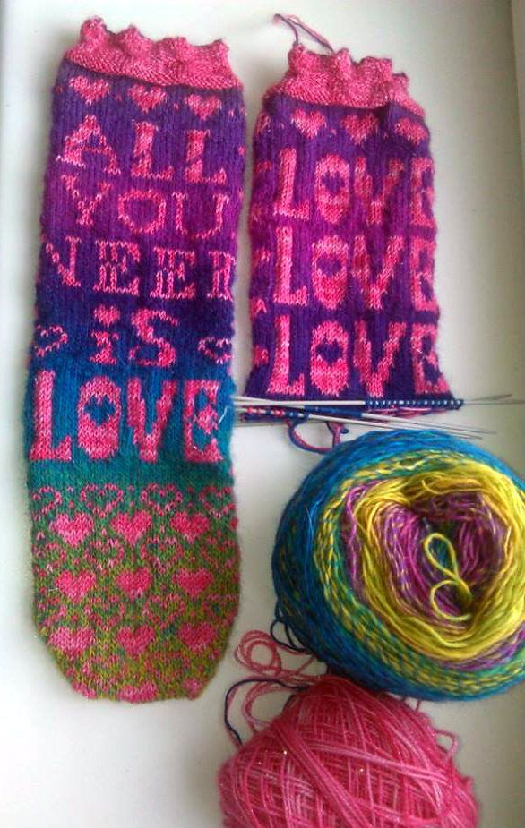"Free Knitting Pattern for All You Need Is Love Socks - Socks with ""All You Need Is Love"" and hearts in stranded colorwork. Designed by Cita Steinmeier. Available in English and Danish. Great with multi-colored yarn to automatically change colors."