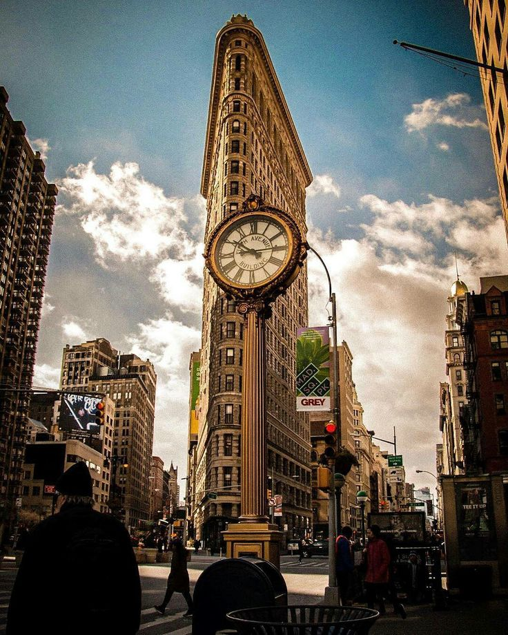 The Flatiron Building by tcuff228 by newyorkcityfeelings.com - The Best Photos and Videos of New York City including the Statue of Liberty Brooklyn Bridge Central Park Empire State Building Chrysler Building and other popular New York places and attractions.