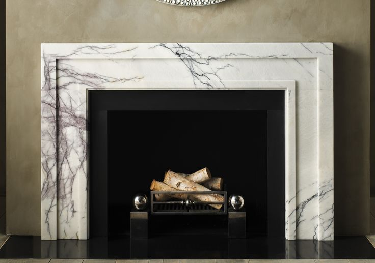 The stunning marble is a great textural element to the simplicity of the mantel.