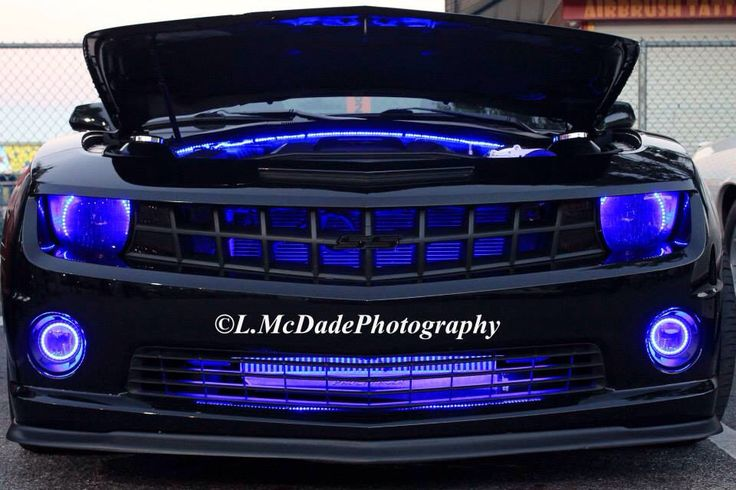 American car kitted out with neon blue lights #carphotography