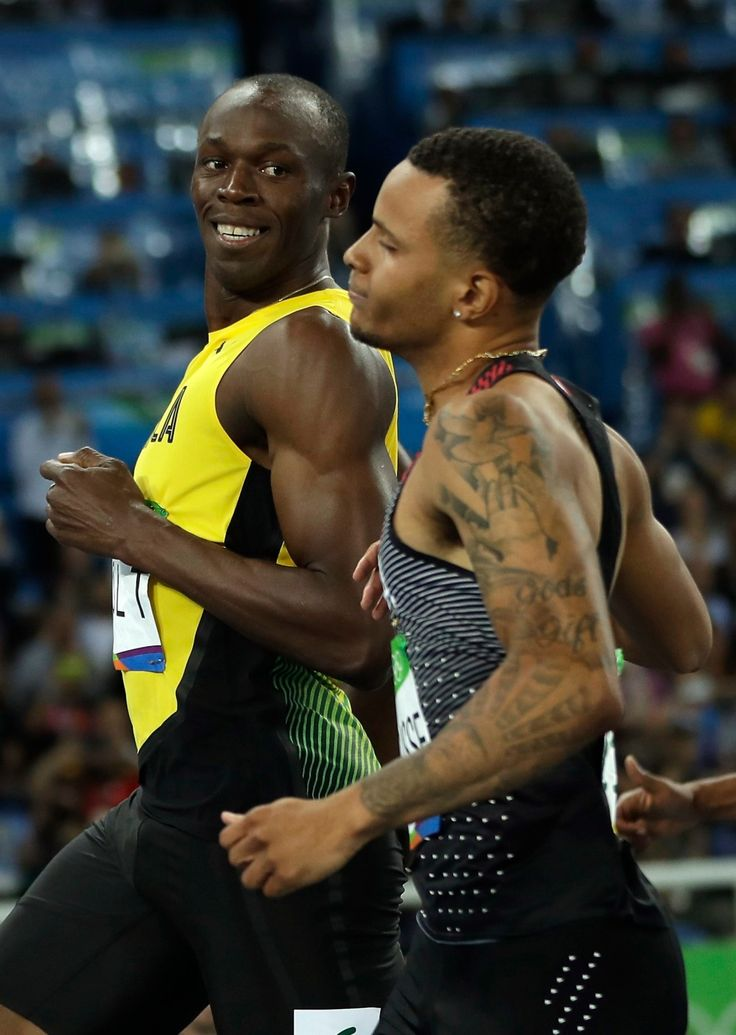 Jamaica's Usain Bolt, left, looks to Canada's Andre De Grasse after crossing the line during a men's 100-meter semifinal during the athletics competitions in the Olympic stadium of the 2016 Summer Olympics in Rio de Janeiro, Brazil, Sunday, Aug. 14, 2016. (AP Photo/Matt Slocum)