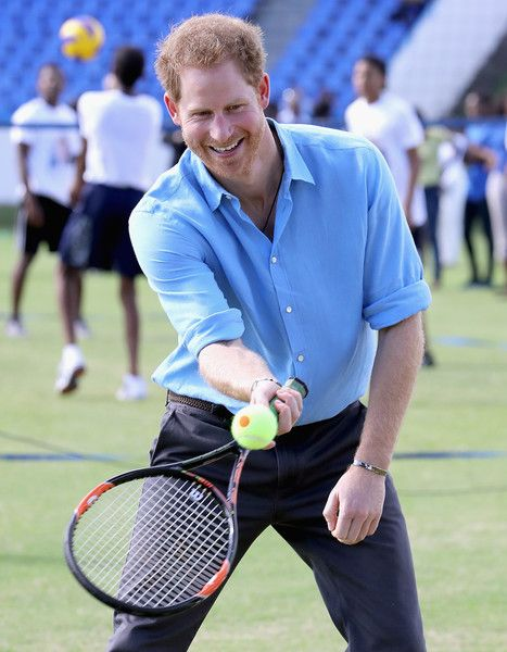 Prince Harry Photos Photos - Prince Harry plays tennis as he attends a youth sports festival at Sir Vivian Richards Stadium showcasing Antigua and Barbuda's national sports, on the second day of an official visit to the Caribbean on November 21, 2016 in Antigua, Antigua and Barbuda. Prince Harry's visit to The Caribbean marks the 35th Anniversary of Independence in Antigua and Barbuda and the 50th Anniversary of Independence in Barbados and Guyana. - Prince Harry Visits The Caribbean - Day 2