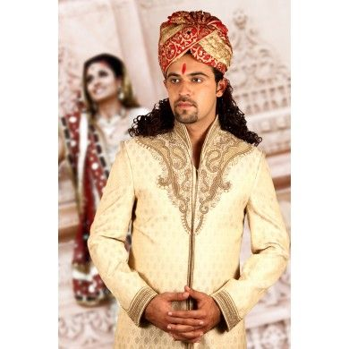 Gold Sherwani with jarkan diamond and moti from bodyline It has #jarkan #diamond and moti studded precisely making it an antique hunter's paradise from exotic collection of #wedding wear #Men'swear #Sherwanis