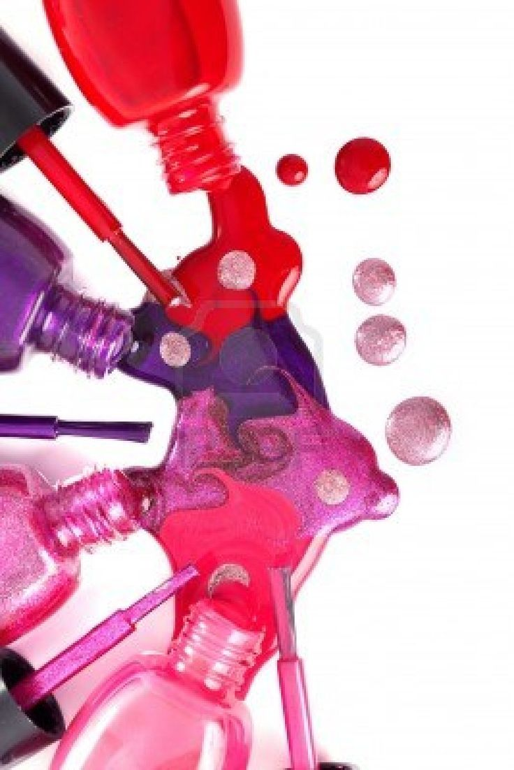 Image of bright-colored nail polish  spilling from bottles Stock Photo