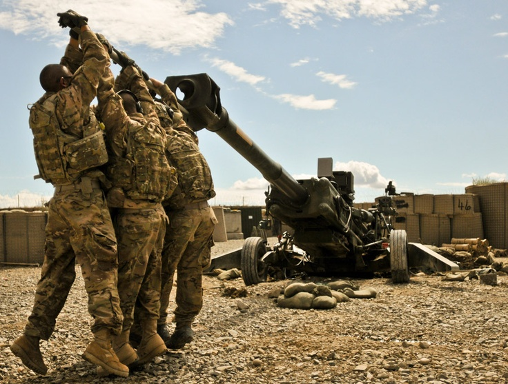 Members of 3rd Platoon, Alpha Battery, 1st Battalion, 77th Field Artillery Regiment, 172nd Infantry Brigade, work at dislodging their M-777 155mm howitzer from the three-foot deep hole it dug its spades into after firing several rocket-assisted projectiles, Sept. 4. The huge weapon weighs 9,000 pounds and can launch projectiles over 30 kilometers.