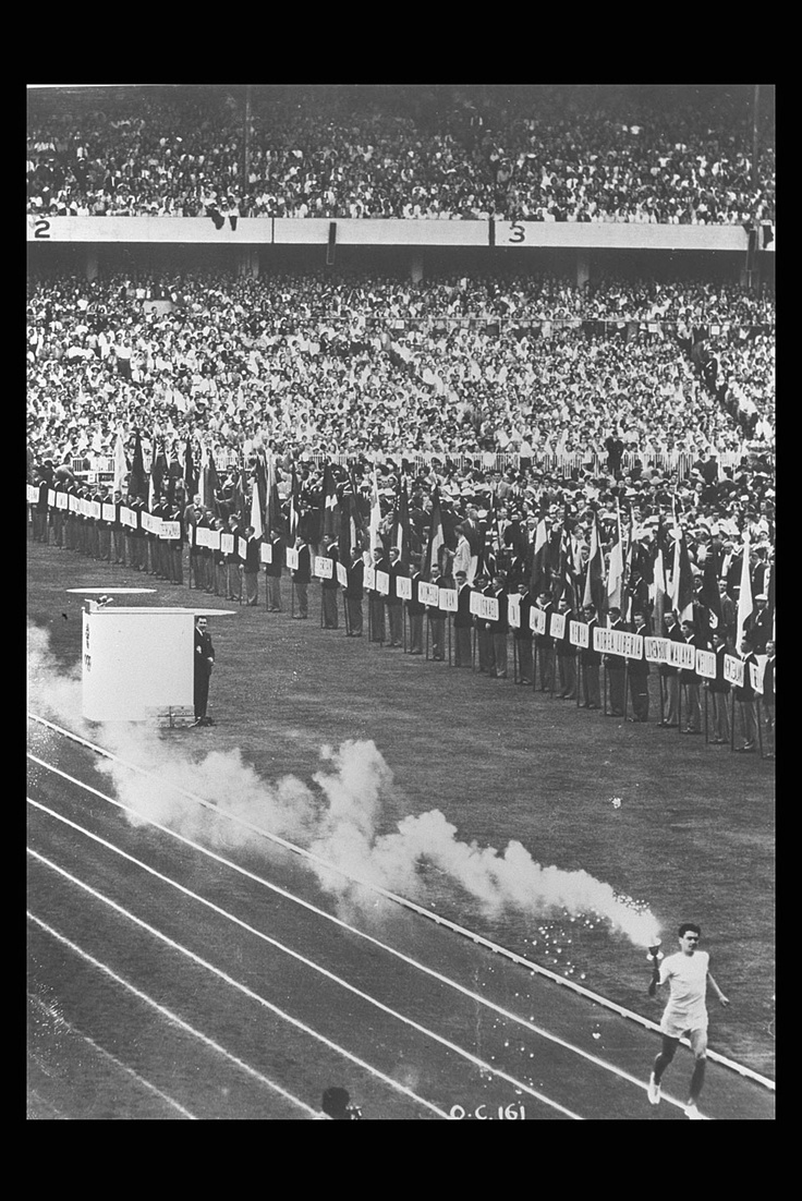 1956 Olympic Games were held in Melbourne Australia, however, the equestrian events were held in Stolkholm, due to Australia's strict quarantine laws. Seen here: Opening Ceremony Melbourne 1956  Ronald Clarke (AUS), the last torchbearer of the Olympic flame, makes a lap of the stadium before lighting the cauldron / ©IOC Harry Jay
