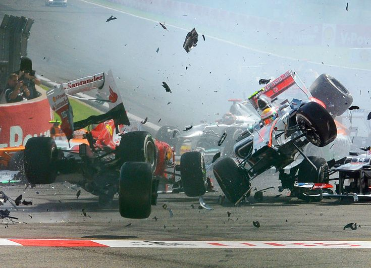 Fernando Alonso and Lewis Hamilton get airborne after being taken out by Romain Grosjean | Formula 1 photos | ESPN F1