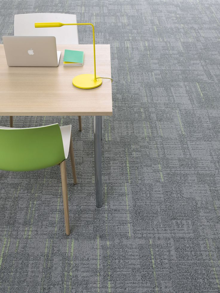 Stitch is an intricate carpet tile contrasting subtle shades with an injection of colour.