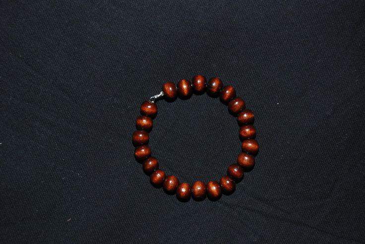 Bracciale rigido perle in legno