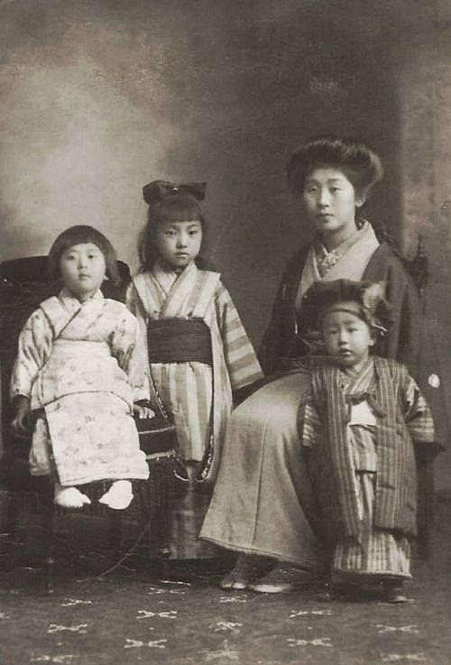 Mother and children. 1920's, Japan
