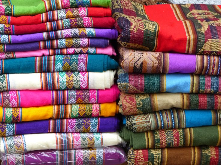 Colorful carpets for sale - Photo by Janet Williams, Group Escort