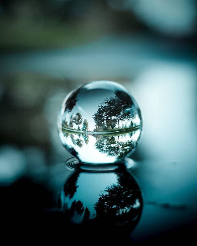 A Gorgeous Blue Bokeh Puddle Capture By Emmyk Photography Lensball Lensballphotography Through Crystal Photography Reflection Photography Bokeh Photography