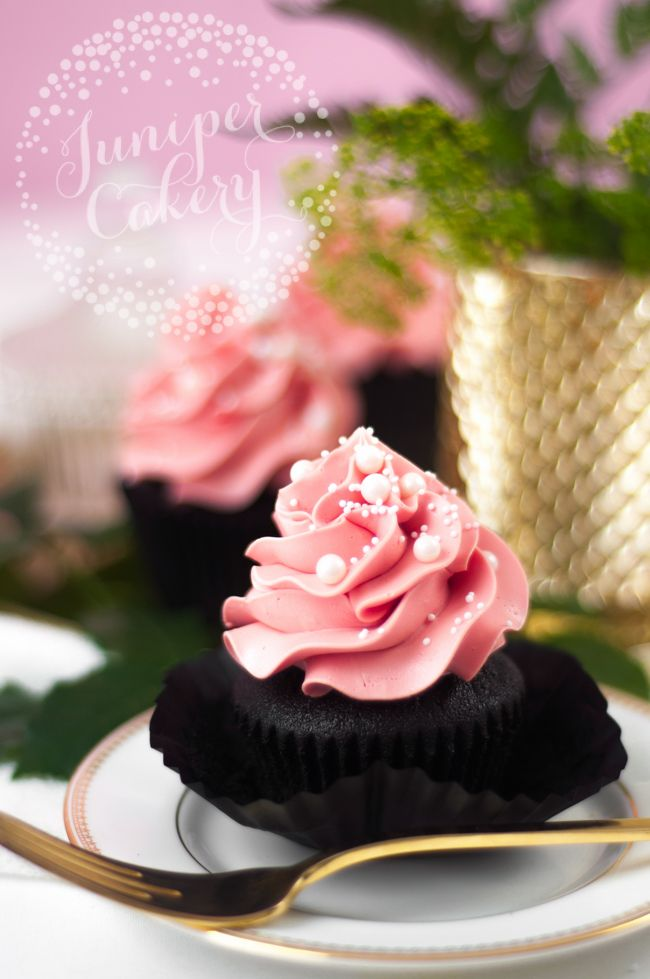 black velvet cupcakes on plate with pink frosting