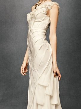 Oh. My. God. This gorgeous gown by the new and modern bridal boutique BHLDN is absolutely stunning! Cut on the bias with a floor-skimming hem, raw-edged silk habotai panels play against cascading georgette ribbons for a texturally complex finish. We are completely obsessed with the #romance of this dress and love the ivory color and one shoulder neckline. $1600. Item Number: 46146Bridal Boutique