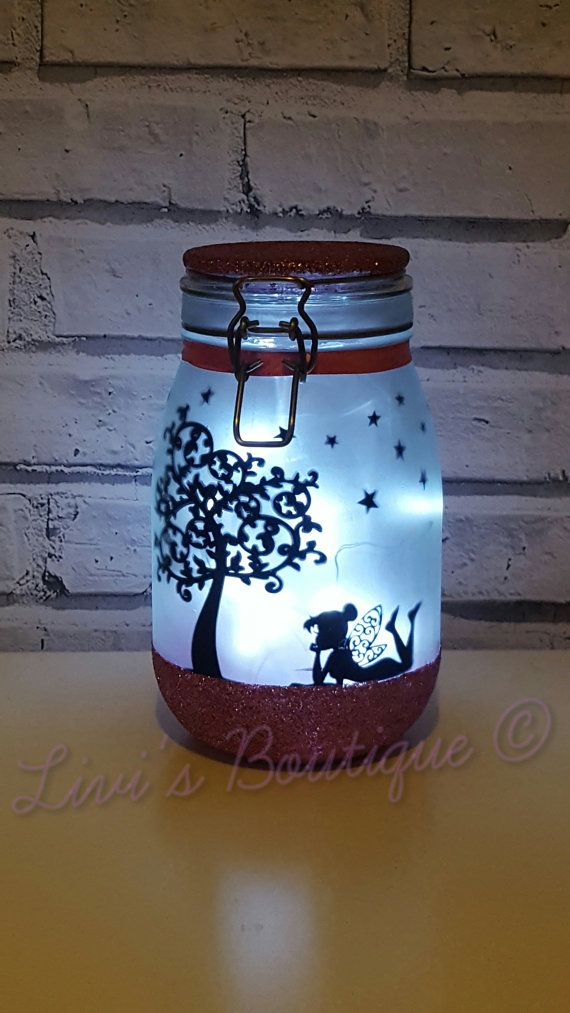 This large personalised childrens fairy night light measures approx 22cm in height and comes with micro LED lights-batteries are not provided due to postage reasons.  These large lights are hand frosted, glittered in your choice of colour on the lid and base with fairy decals inside. When the LED lights are switched on watch your fairy jar come to life!  These fairy jar lights are suitable for a variety of occasions including fairy themed weddings, birthday presents, bridesmaid thank you…
