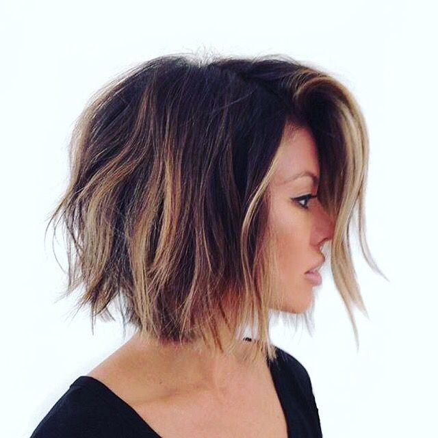 Love love the blonde highlights underneath the dark brunette hair! The short shaggy hair cut makes it even cuter!