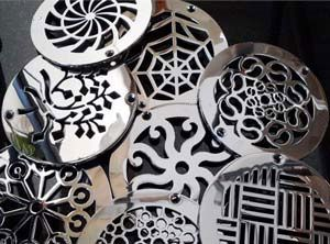 """Gorgeous designer drains are """"jewelry for your shower"""" in a wide variety of styles to suit almost any bathroom!"""