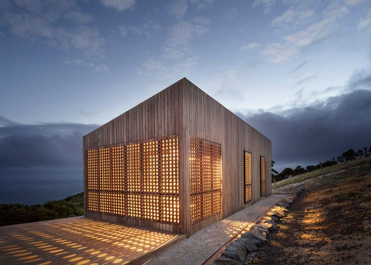 Perforated shutters provide light and ventilation for this holiday cabin.