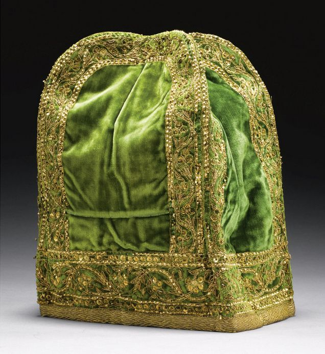 The Hat of Nana Sahib captured at Cawnpore in 1857, India, 19th century, of square section, rounded at the top, made of silk covered in green velvet and embroidered with gold thread and sequins, the base with a band of interlacing silver-gilt wire, with an inscribed collection label , 21.5cm. height 21.5cm. max. diam.