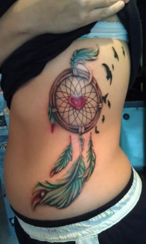 Delicate Heart in Dreamcatcher Watercolor Tattoo on Rib ...