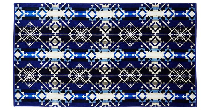 Take Pendleton with you to the beach, pool, or hot tub with this reversible, jacquard-woven beach towel. Featuring a dynamic blanket pattern, this oversize beach towel is made of cotton velour...