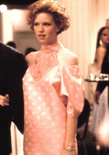 PRETTY IN PINK  As the title suggests, the pink prom dress created by Molly Ringwald's character Andie is one of the stars of this coming-of-age prom film.    FACT: The vintage-cum-hand-me-down creation was actually designed by Marilyn Vance, who was behind the wardrobes for all of John Hughes' Brat Pack films.