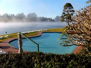 Early morning mist on the Pine Lake, with the pool in the foreground
