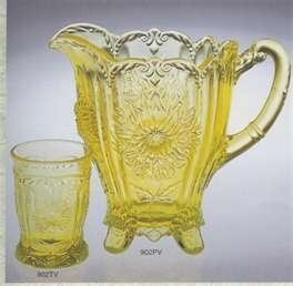 Yellow pressed glass pitcher and glass